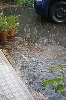 Heavy rain outside a house in Ireland flooding in the driveway