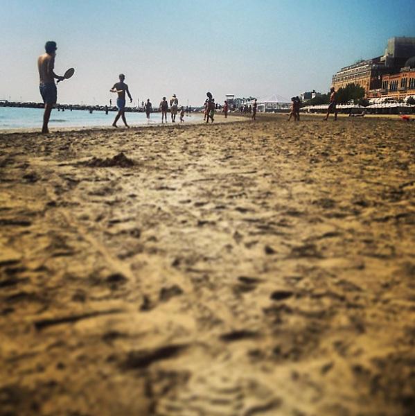 Venice Lido 2015: men playing beach tennis.