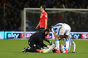 Huddersfield Town striker Isaiah Brown (37) receives treatment as Brighton & Hove Albion central defender Lewis Dunk (5) walks off after receiving a red card during the EFL Sky Bet Championship match between Huddersfield Town and Brighton and Hove Albion at the John Smiths Stadium, Huddersfield, England on 2 February 2017.