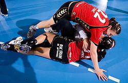 Dragana Cvijic, Jelena Grubisic and Andrea Lekic of Krim celebrate at handball match of Round 3 of Champions League between RK Krim Mercator and Hypo Niederosterreich, on November 8, 2009, in Arena Kodeljevo, Ljubljana, Slovenia.  Krim won 35:24. (Photo by Vid Ponikvar / Sportida)