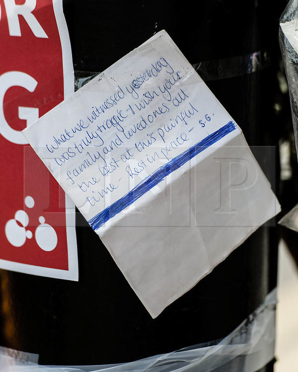 © Licensed to London News Pictures. 16/07/2013. London, UK. Messages of condolence left by members of the public at a memorial to the cyclist killed yesterday by a tipper truck at the scene of the incident in central London Photo credit : Richard Isaac/LNP