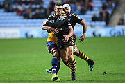 Wasps flyhalf Jimmy Gopperth (12) is tackled during the Gallagher Premiership Rugby match between Wasps and Bath Rugby at the Ricoh Arena, Coventry, England on 2 November 2019.