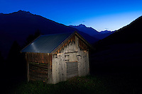 IFTE-NB-007876; Niall Benvie; Haybarn at night; above Fliess; Austria; Europe; Tirol; Fliesser Sonnenhänge; building; horizontal; spotlight; blue brown; upland mountain hill meadow; 2008; July; summer; night evening dusk; artificial light torch; agriculture; Wild Wonders of Europe Naturpark Kaunergrat