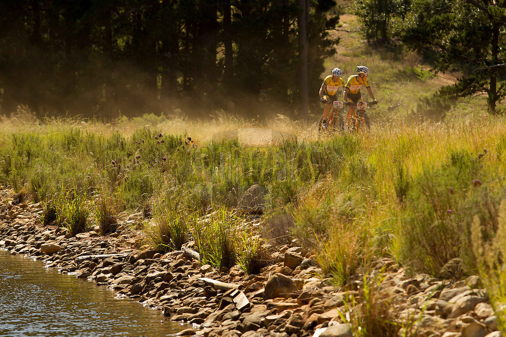 Overall winners Christoph Sauser and Jaroslav Kulhavy of Team Burry Stander-SONGO on their way to finishing the final stage (stage 7) of the 2013 Absa Cape Epic Mountain Bike stage race from Stellenbosch to Lourensford Wine Estate in Somerset West, South Africa on the 24 March 2013..Photo by Greg Beadle/Cape Epic/SPORTZPICS