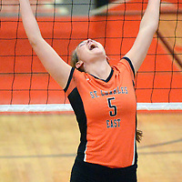 St. Charles East's Alex Mazanke celebrates a point over Geneva in their first match.
