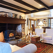GLEN MILLS, PA - JANUARY 7, 2016: The first floor living room, an addition to the house c1740, has a large hearth with wood stove and exposed timber framing. 57 Skyline Drive, Glen Mills, PA. Credit: Albert Yee for the New York Times