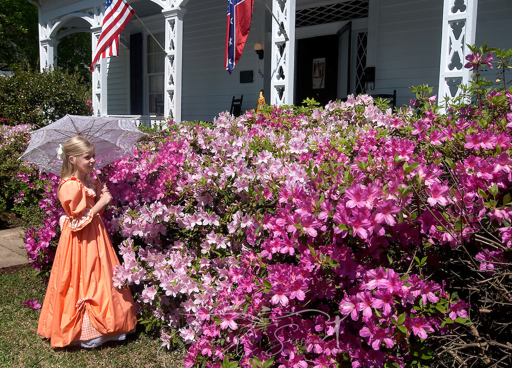 Hannah Brady walks past the azaleas in front of the Amzi Love Home in Columbus, Miss. April 17, 2010. The 1848 home, which has been featured in Fodor's Travel Guide and The New York Times Travel Magazine, was among nearly two dozen on tour during Columbus' annual Spring Pilgrimage. (Photo by Carmen K. Sisson/Cloudybright)