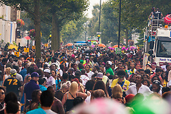 London, August 24th 2014. Crowds chole Ladbroke Grove as revellers participate in 2014's Notting Hill Carnival in London, celebratingWest Indian and other cultures, and attracting hundreds of thousands to Europe's biggest street party.