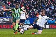 AFC Wimbledon defender Jonathan Meades (3) is stopped by Bolton Wanderers defender David Wheater (31)  during the EFL Sky Bet League 1 match between Bolton Wanderers and AFC Wimbledon at the Macron Stadium, Bolton, England on 4 March 2017. Photo by Simon Davies.