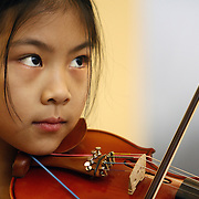 White Plains, NY / 2009 - Janine Liu listens to instruction while participating in a Suzuki group music session at the Music Conservatory of Westchester Jan. 12. ( Mike Roy / The Journal News )