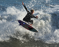 © Licensed to London News Pictures. 07/10/2012..North Bay, Scarborough, Yorkshire..The Scarborough Surf Festival returned to North Bay in Scarborough featuring Round 3 of the UK Professional Surf Tour ...The best professional surfers in the UK wattended to display their talents and compete to win the UK Professional Surfing Title...Last year over 10,000 people attended the event and this year's Festival featured live music from local bands and a freestyle mountain bike shows...Photo credit : Ian Forsyth/LNP