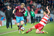 Doncaster Rovers Defender Andrew Butler (6) slides in on Scunthorpe United striker Paddy Madden (9) during the The FA Cup match between Doncaster Rovers and Scunthorpe United at the Keepmoat Stadium, Doncaster, England on 3 December 2017. Photo by Craig Zadoroznyj.