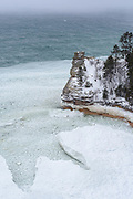 UPPER PENNINSULA, MICHIGAN - FEBRUARY 2017: Miners Castle seen on a windy and snowy day February 15, 2017 in Pictured Rocks National Lakeshore near Munising, Michigan. While some shelf ice had formed at the base of the cliff and pancake ice floated in the waves there was still a lot of open water on Lake Superior due to the fairly mild winter. To reach the overlook in winter requires a much further hike, snowshoe or ski trip then in summer. Miners Castle Road is only plowed to Carmody Road in winter. You can park where the plowing ends and from there its about 3.5 miles to the overlook. There is an easier way of you have a snowmobile since they are allowed on Miners Castle Road. Just ride to the parking area and then its less then 100 years to the overlook. Photographer Bryan Mitchell spent a week in February wandering around to some of his favorite places in the UP to make some winter photos. (Photo by Bryan Mitchell/Special to Detroit News)