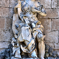 Fountain Statue of Abundance at Monte di Pietà in Messina, Italy <br /> In the center of the staircase of the Monte di Pietà is a water fountain with this statue of a woman. She is called Abundance. This work was designed by Campolo and sculpted by Ignatius Buceti in 1741. It was damaged by an earthquake and bombings during World War II.