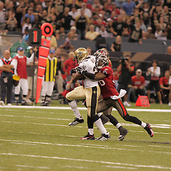 2008 September 7: New Orleans Saints running back Reggie Bush (25) tries to break the tackle of Tampa Bay Buccaneers safety Tanard Jackson (36) during their game at the Louisiana Superdome in New Orleans, LA.  The New Orleans Saints defeated the Tampa Bay Buccaneers 24-20.
