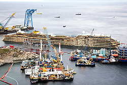 60490191<br /> Isola del Giglio, Italy. <br /> A view of the wreck of Italy's Costa Concordia cruise ship after it emerged from the water on September 17, 2013, near the harbour of Giglio Porto. On 13 January 2012, she was wrecked off the coast of Isola del Giglio in Italy. She has been declared a total loss and is being salvaged as of 2013, following which she will be scrapped, Italy, Tuesday September 17, 2013,<br /> Picture by imago / i-Images<br /> UK ONLY