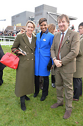 Left to right, ANNOUSHKA DUCAS, DENISE LEWIS and JOHN AYTON at the 2015 Hennessy Gold Cup held at Newbury Racecourse, Berkshire on 28th November 2015.