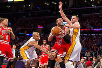 25 December 2011: Forward Carlos Boozer of the Chicago Bulls drives to the basket while bing guarded by Josh McRoberts of the Los Angeles Lakers during the first half of the Bulls 88-87 victory over the Lakers at the STAPLES Center in Los Angeles, CA.
