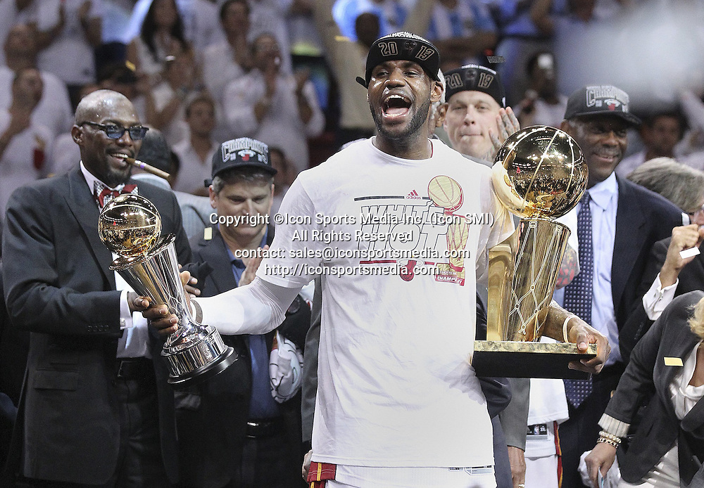June 20, 2013 - Miami, FL, USA - LeBron James, the series MVP< holds trophies after a 95-88 win against the San Antonio Spurs in Game 7 of the NBA Finals at the AmericanAirlines Arena in Miami, Florida, on Thursday, June 20, 2013
