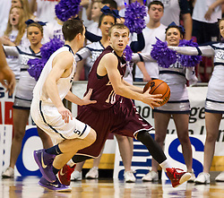 Woodrow Wilson guard Corey Acord (10) looks to throw the ball down court against Parkersburg South during a semi-final game at the Charleston Civic Center.