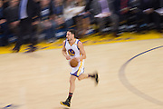 Golden State Warriors guard Klay Thompson (11) pushes the ball down the court against the Charlotte Hornets at Oracle Arena in Oakland, Calif., on February 1, 2017. (Stan Olszewski/Special to S.F. Examiner)