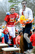 Two participants, dressed as zombies, dance atop brick pillars following the 8th annual Krispy Kreme Challenge Friday February 4, 2012, in Raleigh.