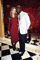 Fashion designer OZWALD BOATENG and his wife GYUNEL at a party to celebrate the 10th Anniversary of Claridge's Bar, Claridge's Hotel, Brook Street, London on 11th November 2008.