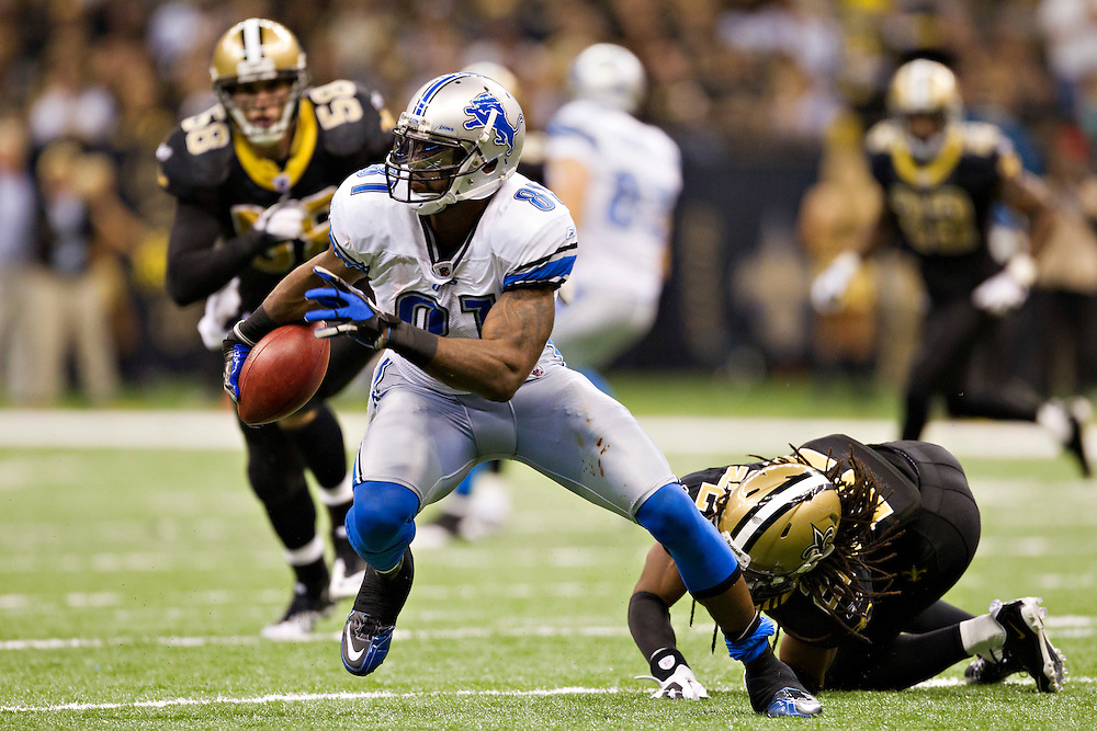 NEW ORLEANS, LA - DECEMBER 4:  Calvin Johnson #81 of the Detroit Lions runs the ball against the New Orleans Saints at Mercedes-Benz Superdome on December 4, 2011 in New Orleans, Louisiana.  The Saints defeated the Lions 31-17.  (Photo by Wesley Hitt/Getty Images) *** Local Caption *** Calvin Johnson