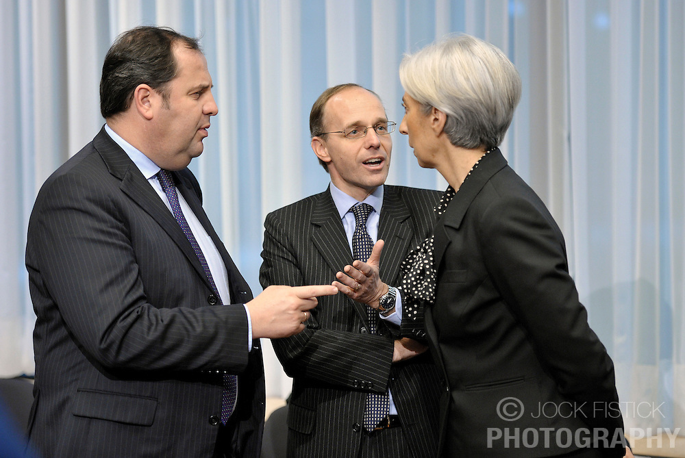 Luc Frieden, Luxembourg's finance minister, center, speaks with Josef Proell, Austria's finance minister, left, and Christine Lagarde, France's finance minister, right, during the Eurogroup meeting in Brussels, Belgium, on Monday, Feb. 15, 2009. (Photo © Jock Fistick)