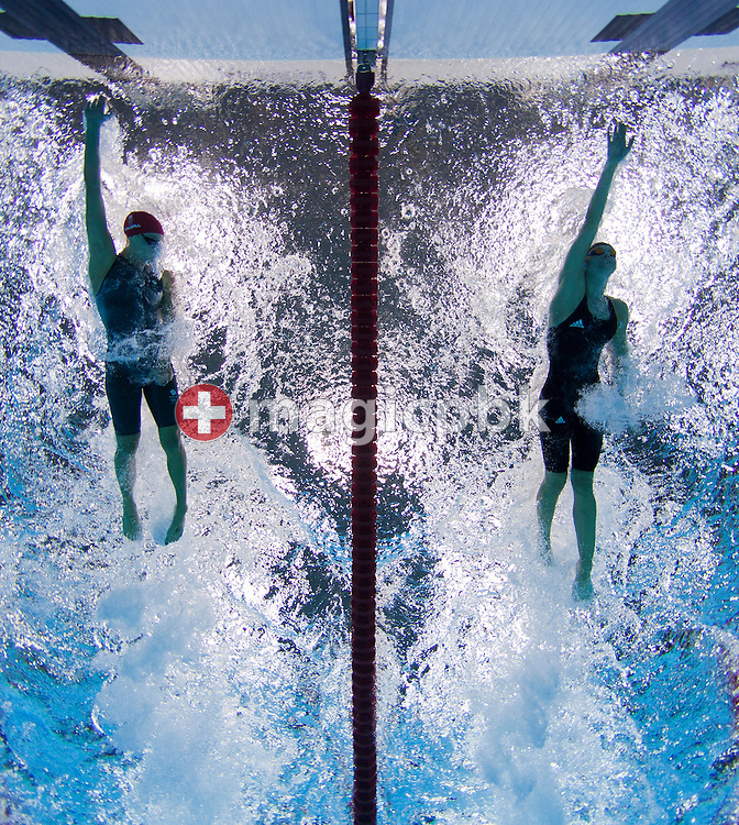 Francesca Halsall (L) of Great Britain and Britta Steffen of Germany compete in the women's 50m Freestyle Heats during the Swimming competition held at the Aquatics Center during the London 2012 Olympic Games in London, England, 3 August 2012.