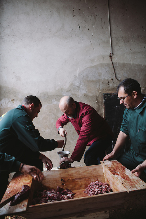 Food writer Tim Hayward produces sausage meet from the Iberico pig which is placed into an artesa (the wodden tub).. Finca Al Cornocal, Extramadura (Barajoz Province), Spain.