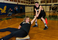 Janelle Page goes for a wild scooter ride with partner Bech Stecher during Gilford High School's Winter Carnival games on Friday afternoon.  (Karen Bobotas/for the Laconia Daily Sun)