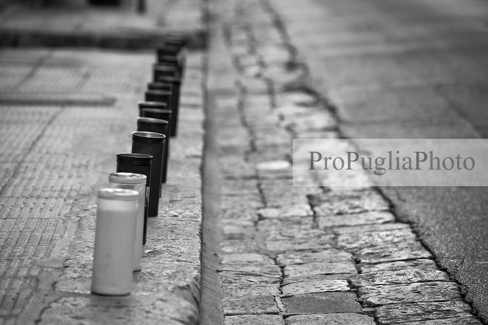 Botrugno - Processione dei Misteri - 30 marzo 2013. La processione parte dalla Cappella dell'Assunta, alle spalle della Chiesa Madre, alle 6 del mattino. I fedeli e i membri della Confraternita dell'Assunta accompagnano nelle strade del paese le statue del Cristo Morto e della Madonna Addolorata. La processione &egrave; preceduta dalla Croce dei Misteri sorretta dai giovani del paese, poi in successione &egrave; il turno delle donne del posto (vestite di nero con camicia e guanti bianchi) che sorreggono la statua del Cristo torturato. La processione continua con la statua del Cristo Morto, sorretto dagli uomini del paese vestiti con lo stesso tipo di abbigliamento e infine la statua della Madonna Addolorata che chiude la processione. Alla fine della processione, intorno alle 8, tutte statue vengono riportate nella Cappella dell'Assunta ed esposte per la contemplazione.<br /> Botrugno - The Procession of the Mysteries - March 30, 2013. The procession starts from the Chapel of the Assumption, behind the Cathedral Church at 6 o'clock in the morning. The faithful and members of the Brotherhood of the Assumption accompany in the streets of the statues of the dead Christ and Our Lady of Sorrows. The procession is preceded by the Cross of the Mysteries supported by the youth of the country, then in succession is the turn of the local women (dressed in black shirt and white gloves) that hold the statue of Christ tortured. The procession continues with the statue of the dead Christ, supported by the men of the village dressed with the same kind of clothes and finally the statue of Our Lady of Sorrows, which closes the procession. At the end of the procession, around 8 am, all statues are reported in the Chapel of the Assumption and exposed for contemplation.