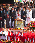 Salvadoran Catholic priests carry a relic - the blood stained shirt - of martyred Archbishop Oscar Romero to the beatification ceremony and mass for the slain priest. Salvadoran politicians with which the priest was frequently at odds stand in the background to honor him. The Archbishop was slain at the alter of his Church of the Divine Providence by a right wing gunman in 1980. Oscar Arnulfo Romero y Galdamez became the fourth Archbishop of San Salvador, succeeding Luis Chavez, and spoke out against poverty, social injustice, assassinations and torture. Romero was assassinated while offering Mass on March 24, 1980.