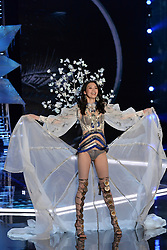 Ming Xi on the catwalk for the Victoria's Secret Fashion Show at the Mercedes-Benz Arena in Shanghai, China