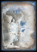 extreme deteriorating glass plate surface with group portrait France ca 1920s
