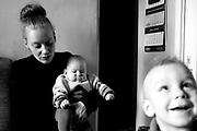 21/3/2011.Targówek, Warszawa, Poland. M. T., 27, together with her 2 sons (3 years old, and 6 months old) found shelter at her mother's house in Targowek (Warsaw). She escaped from her violent alcoholic husband that beat her and burnt cigarettes on her hands in front of the children.The flat of the mother (H. T.) is only 18 m2 and here lives also Mr G., unemployed, sick, who weights about 200 Kg. There is no toilette or bathroom in the flat and M. sleeps on a mattress in the kitchen with her 2 sons. The family collects scrap metal and used clothes during the week, and then sells them at Olimpia Flee Market every Sunday. An old friend of H. T., J. (62 years old) that helps them in collecting stuff to sell, visits them everyday and usually has his lunch (and drinks) here too.