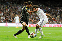 Real Madrid´s Marcelo Vieira and Malaga´s Sergio Sanchez Ortega during 2014-15 La Liga match between Real Madrid and Malaga at Santiago Bernabeu stadium in Madrid, Spain. April 18, 2015. (ALTERPHOTOS/Luis Fernandez)