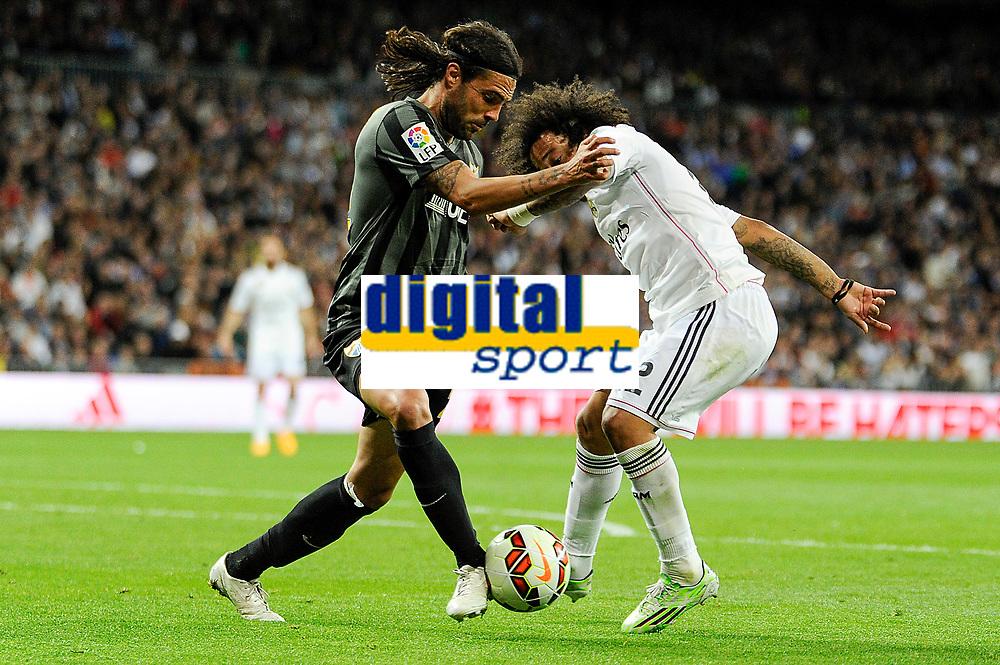 Real Madrid´s Marcelo Vieira and Malaga´s Sergio Sanchez Ortega during 2014-15 La Liga match between Real Madrid and Malaga at Santiago Bernabeu stadium in Madrid, Spain. April 18, 2015. (ALTERPHOTOS/Luis Fernandez)