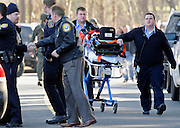 An empty gurney is pushed by medics away from Sandy Hook Elementary School, after a mass shooting that claimed the lives of 26 people, including 20 children in Newtown, Conn., Friday, Dec. 14, 2012. (AP Photo/Jessica Hill)