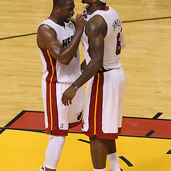 Jun 19, 2012; Miami, FL, USA; Miami Heat shooting guard Dwyane Wade (3) and small forward LeBron James (6) react during the fourth quarter in game four in the 2012 NBA Finals at the American Airlines Arena. Miami won 104-98. Mandatory Credit: Derick E. Hingle-US PRESSWIRE