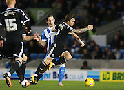 Brentford midfielder Sam Saunders gets the better of Brighton central defender Lewis Dunk during the Sky Bet Championship match between Brighton and Hove Albion and Brentford at the American Express Community Stadium, Brighton and Hove, England on 5 February 2016. Photo by Bennett Dean.