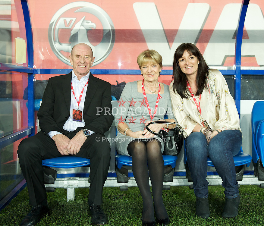 CARDIFF, WALES - Wednesday, February 29, 2012: Gary Speed's sister Lesley and his parents Roger and Carol on the bench before the international friendly match at the Cardiff City Stadium. (Pic by David Rawcliffe/Propaganda)