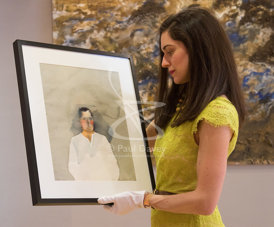 Bonhams, London, March 6th 2017. Fine art auctioneers Bonhams hold a preview in London  for their upcoming Post-War and Contemporary Art Sale which takes place on March 8th 2017. PICTURED: A member of Bonhams staff holds David Hockney's watercolour 'Howard Hodgkin' valued between £40,--- and £60,000.