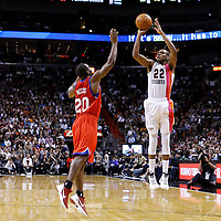21 January 2012: Miami Heat small forward James Jones (22) takes a jumpshot over Philadelphia Sixers guard Jodie Meeks (20) during the Miami Heat 113-92 victory over the Philadelphia Sixers at the AmericanAirlines Arena, Miami, Florida, USA.