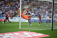 Picture by Graham Crowther/Focus Images Ltd. 07763140036.10/9/11 .Gary Roberts of Huddersfield scores the opening goal against Tranmere during the Npower League 1 game at the Galpharm Stadium, Huddersfield.