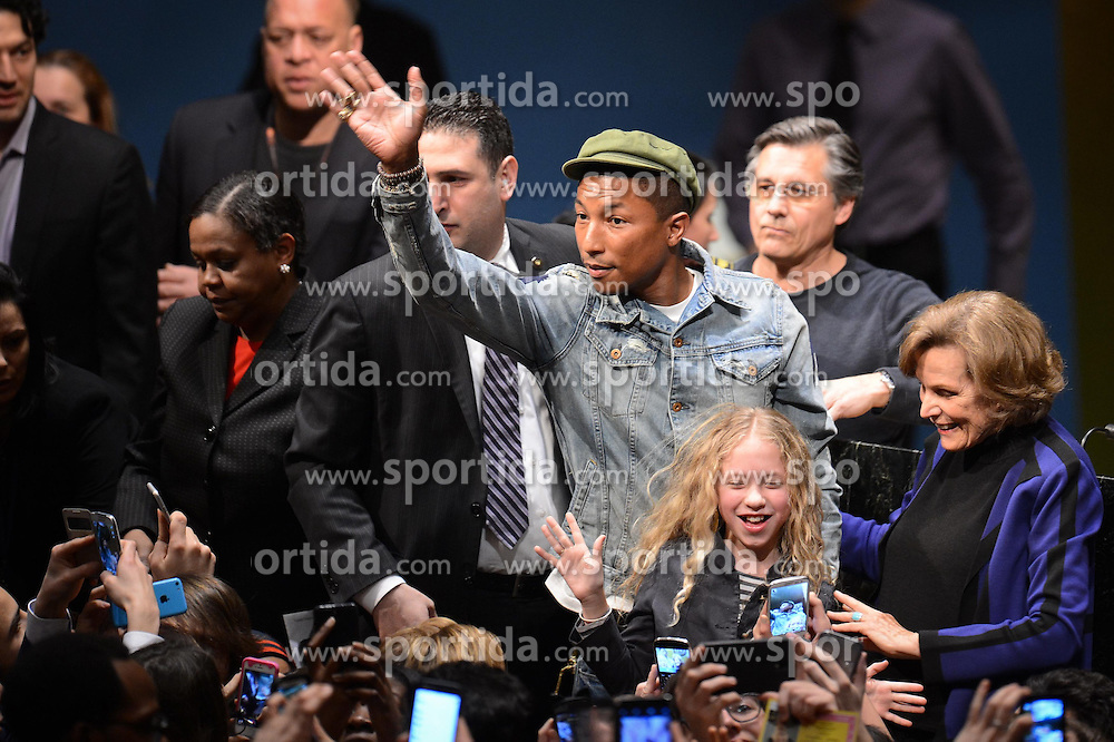 Singer Pharrell Williams waves to fans during an event marking the International Day of Happiness at the UN headquarters in New York, on March 20, 2015. Grammy-winning singer Pharrell Williams joined the United Nations to celebrate the International Day of Happiness on Friday, with an emphasis on reaching out to young people and move them to take action on climate change. EXPA Pictures &copy; 2015, PhotoCredit: EXPA/ Photoshot/ Niu Xiaolei<br /> <br /> *****ATTENTION - for AUT, SLO, CRO, SRB, BIH, MAZ only*****