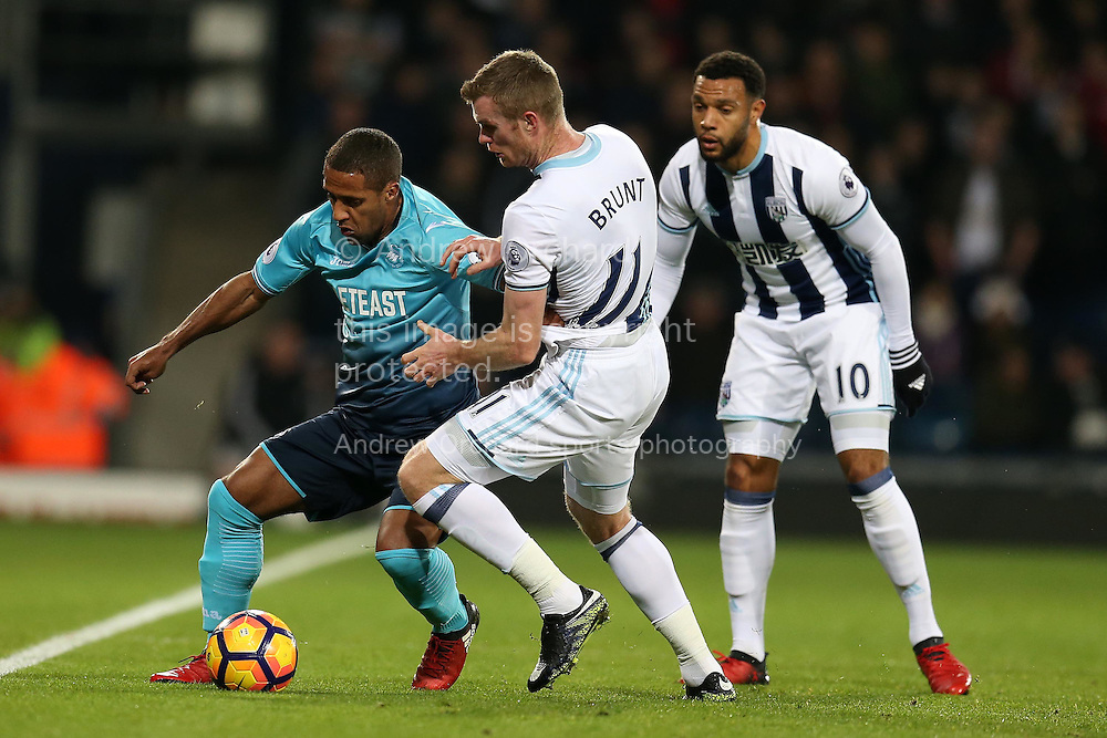 Wayne Routledge of Swansea city (l)  is challenged by Chris Brunt of West Bromwich Albion. Premier league match, West Bromwich Albion v Swansea city at the Hawthorns stadium in West Bromwich, Midlands on Wednesday 14th December 2016. pic by Andrew Orchard, Andrew Orchard sports photography.
