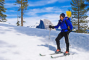 Backcountry skier and Half Dome from Glacier Point, Yosemite National Park, California