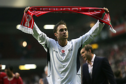 LIVERPOOL, ENGLAND - SUNDAY MARCH 27th 2005: Celebrity XI's and Liverpool supporter Marcus Patrick holds a scarf after the during the Tsunami Soccer Aid match at Anfield. (Pic by David Rawcliffe/Propaganda)